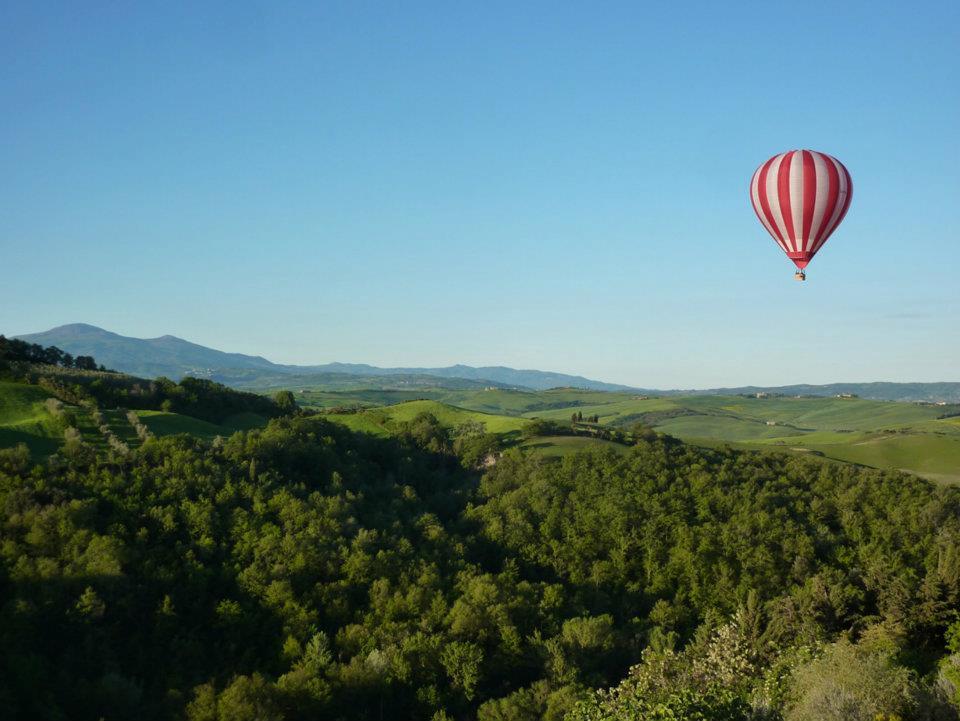 Balloon over tuscan hills